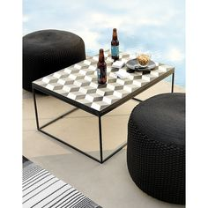 Shop tangier coffee table.   Shades of black, grey and white fashion a fresh take on cubism.  Designed by Hettler. Tüllmann, open box construction in powdercoated steel insets handmade cement tiles with sunwashed color and a surprise optical illusion.