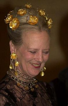 Queen Margrethe II wearing the Golden Poppies Tiara, Denmark (1976; made by Arje Griegst; gold, baroque pearls, moonstones, aquamarines, pearls, crystals, opals, diamonds).