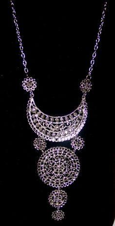 Warzazat Necklace - $20.00   Our new jewelry collection is handmade and imported from Morocco. These pieces are reproductions of the antique creations that have been part of the traditional jewelry for the past hundred years. Made of Metal.   Measurement: 26 inches long. https://treasuresofmorocco.com/shop/?slug=product_info.php&cPath=81_24&products_id=270