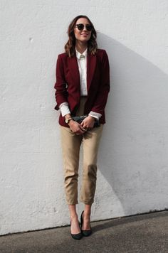 Oxblood blazer, beige tapered trousers