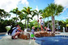 Family Fun splashing at the Children's Garden at Naples Botanical Gardens. Naples, FL. Photo credit Debi Pittman Wilkey