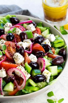 This Greek salad is a healthy vegetable packed appetizer drizzled with a homemade red wine vinegar dressing. Each serving contains creamy feta cheese, kalamata olives, tomatoes, bell peppers, cucumbers, and red onion. #greeksalad #greekfood #feta #salad