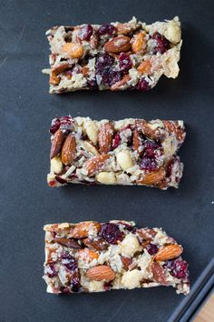 Homemade snack bars. Grain free, no refined sugars & vegan - these Cranberry Almond Snack Bars are super chewy & completely addictive.