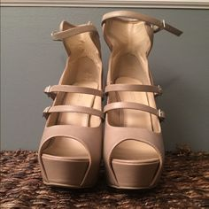 """Platform shoes Tan platform heels. 5/6"""" heel. Never worn. I love these heels but I can't walk in any heel well at all. Straps for around your ankle. Shoes Platforms"""