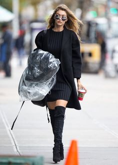 8fc37c13de1 Gigi Hadid swapped standard tights for over-the-knee boots that she paired  with