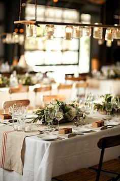 rustic tablescape in earth tones. Also love the light in the back and the mason jars as light above the tables
