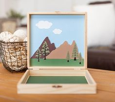 Forest in a Box – DIY This adorable forest set is fun to put together AND fun to play with. Keeping it in a little box means I can throw it in the car or my bag for kid fun on the go. Waiting for our table at a restaurant just got a lot more fun!  This project is built using four Make It Now projects. This file contains images for the box front and the scene inside only. . Images are from the Cricut® Woodland Animals, Cricut® Dinosaur Tracks and Cricut® Craft Room Basics digital cart…