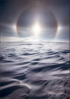 Snow waves and sun dog...ice crystals in the air as the sun in low in the sky can create the right conditions for this beautiful display around the sun called sun dog.