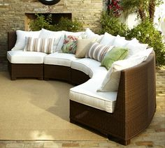 Palmetto All-Weather Wicker Rounded Sectional. if I lived somewhere it was warm all year I around I would totally want a sectional couch for my outdoor area.