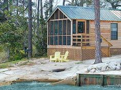 this is where Jody and I stay when we go to the beach on a tight budget:)  Waterfront Cabins at Navarre Beach Campground, Navarre, FL