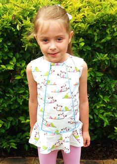 Sweet Piped Peplum Top in bird print on white, blue piping and multi colour buttons.  Fabric from The Oz Material Girls