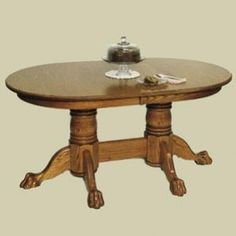 Redux Antique Dining Tables - Heritage Colonial Oval Double Pedestal Claw Foot Extension Dining Table. Available in premium Oak, Maple, & Cherry hardwoods and a full range of durable finishes. 2 models with 2 or 4 extension leaves, and a choice of Custom table edge profiles. Find the Heritage Colonial Oval Double Pedestal Claw Foot Extension Dining Table at http://www.mennonite-furniture-studios.com/Amish-Heritage-Colonial-Oval-Claw-Foot-Double-Pedestal-Extension-Table-(2-Leaves)/