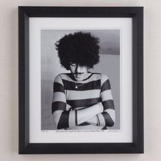 "Philip Lynott does his Denis the menace impression at his home in Howth, Dublin city 1983.  Photo is a limited edition print size 10"" x 12"" signed, numbered, stamped and framed in black box frame by the photographer Colm Henry.     Delivery  - Unless especially specified I will ship your item 1 - 3 days after payment is made.  Shipping to Ireland € 7.50  Shipping to EU €10.00  Shipping to Rest of World €12.50  Payment Method  - ..."