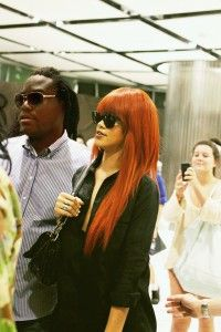devin gibson director and rihanna exiting studio lobby NYC   The Look Red Orange flat ironed long mane  celeb casual