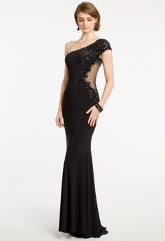 Pure elegance takes form in this long Camille La Vie jersey dress. This graceful one shoulder gown is embellished beautifully with a beaded cap sleeve, illusion side detail, and pretty beaded appliques along the entire length of the bodice. A sleek sheath skirt sweeps effortlessly to the floor creating a sexy silhouette for any formal party scene. Wear this glamorous cocktail dress to a formal gala, as a wedding guest dress, or as a chic and sophisticated prom dress.   •Asymmetrical ...
