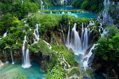 Plitvice Lakes, Croatia  - The cascading waterfalls and winding pathways are amazing...even in the pouring rain.
