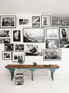 Black and white gallery wall with rustic found furnishings. #modern #rustic #home