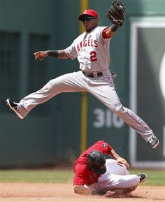 Boston Red Sox's Jacoby Ellsbury, bottom, steals second base as Los Angeles Angels' Erick Aybar (2) comes down with the high throw in the fourth inning of the first baseball game of a doubleheader in Boston, Saturday, June 8, 2013. (AP Photo/Michael Dwyer)