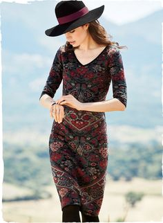 Stylized florals in opulent hues of plum, smoke blue, henna and clay on black capture the beauty of a vintage Persian carpet. The sultry sheath is jacquard knit of pima with a deep double v-neck and ¾-sleeves.