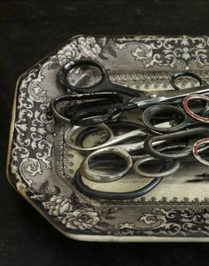 lovely old collection of scissors on a silver tray
