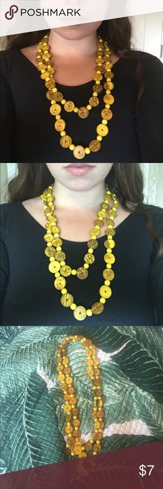 Yellow Bead Necklace - BUNDLE & SAVE Brand unknown. Yellow necklace made of buttons. Fun and bright. Can be worn looped around for a layered look or long.  BUNDLE DEALS FOR NECKLACES ON MY PAGE: 2 - $10 3 - $15 4 - $17 5 - $20  Or make me an offer! undefined Jewelry Necklaces