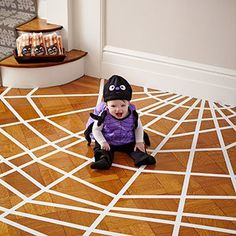 craftyminded:    DIY: Spider Web Room  Just use white painter's tape to create this web effect!    That's so cute how they used the rest of the roll of tape to stick the baby down.--cubie