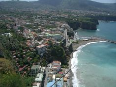 Sorento, Italy... Been in the black sand on that exact beach.. Of course the water too. Who could keep me out of water. (: