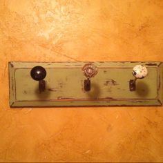 Doorknob coat rack. Have about 6 old doornobs in my basement, yes!