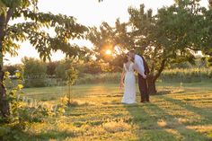This is the way you'll want to remember your wedding.  Candid, uncontrived, sunset, apple orchard, Niagara on the Lake, summer, wedding photography, bride and groom, husband and wife, I do.