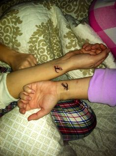 sister tattoo with each of our initials
