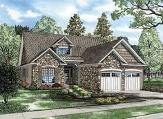 Stone and cedar create a unique exterior featured on this beautiful Cottage style home.  House Plan # 1517412.