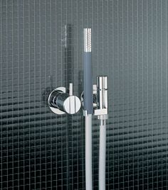 One-handle hand shower with ceramic disc technology from Vola. You can see more from Vola at ibathtile.com.