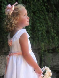 An angelic flower-girl dress using children's Corner pattern #77 Louise in linen with ribbon rosettes and a little redrafting. Look at Newsletter Ideas archive.
