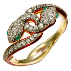 I can only look and pics of this bracelet because I do not have $35k and if I did, I could not justify it to myself to buy a $35k bracelet.  Diamond Victorian Double Snake Bracelet - Late 19th century imported Victorian snake bracelet w/ the two heads entwined. The snakes are encrusted with old mine cut diamonds; both heads with emerald eyes. The bracelet is gold with red enamel.  Price: $35,000