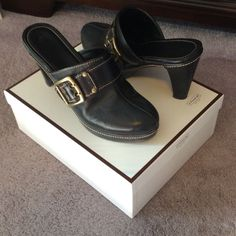 Coach Clogs Pre loved but in great shape. Some very minor scuff on heel. Style A0347. Candace C logo black on black. Width M. Gold buckle. Classy and comfortable with tons of life left in these beauties. Coach Shoes Mules & Clogs