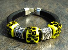 Regaliz Bracelet, Genuine Black Leather with Handmade Black and Yellow dotted Lampwork Beads Tiny Necklace, Glass Necklace, Black Leather Bracelet, Handmade Beads, Lampwork Beads, Antique Silver, Gifts For Women, Glass Beads, Cuff Bracelets