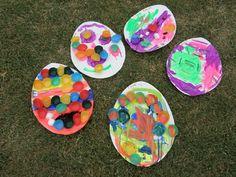 Collage Eggs. Cute I like the idea of gluing on little cupcake liners. Cute idea.