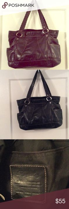 """Fossil black leather handbag 16 """" wide and 11 """" long straps are 11"""". Bottom is clean.  Side pockets 5"""" deep.  Black with white stitches.  Straps reinforced  with leather roping. Fossil Bags Baby Bags"""
