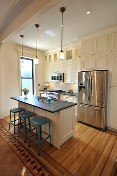 Old hardwood floor border in a restored kitchen, Brooklyn, New York. By Mrs. Limestone.