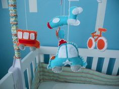 A car, a city bus, a bicycle and more made from felt make this DIY baby mobile that a mom (very comfortable with crafts projects) made for her baby boy's Cityscape Nursery theme décor.  She made it using a recycled crib mobile and lots of love.