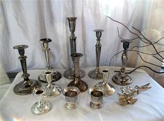 collection of silver candlesticks