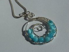 Inspired by the majestic aqua hues and spiraling waves of the ocean, this stunning homemade pendant project is a unique and gorgeous statement jewelry piece.