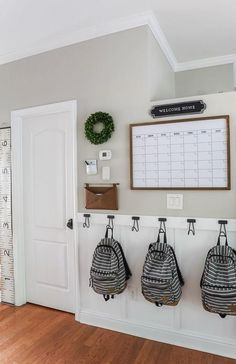 DIY Board & Batten Drop Zone - Perfect for any hallway or small wall entryway! Super simple tutorial