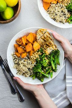 Buddha Bowl with sweet potatoes, wild rice, grilled chicken and broccolini is a great recipe that is easy to make. It is a perfect healthy dinner idea for busy weeknights. #healthyrecipes #dinnerrecipes #easydinner