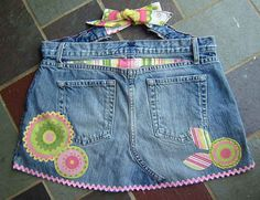 pocketed apron...but cute idea to dress up Lily's jeans that she's grown too long for in the legs :) Lots of ideas going now!