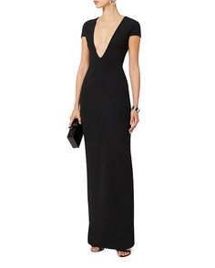 Solace London Mason Deep V Gown: A statuesque gown with a deep V neckline and capped sleeves. Zip closure at back. Slit at back hem. In black.   Fabric: 95% polyester/5% elastane   Imported. Model Measurements: Height 5'8.5 ; Waist 24 ; Bust 33 wearing size 2   Length from shoulder to ...