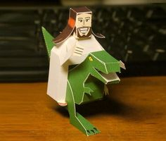 """Jesus Riding A Dinosaur Paper Toy - by Digitprop - Jesus Cavalgando Um Dinossauro  --              The Image That Inspired Markus  Markus, designer of this model, says: - """"There seem to be people who believe that dinosaurs weren't extinct at all when Jesus walked the earth. It's hard to stomach, but the Beginner's Bible Coloring Book clearly endorses this belief. I actually assumed that this was fake, but a background check on the internet didn't yield much.  - read more at Papermau!"""