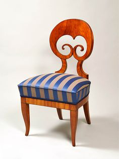 Biedermeier chair.  (I have a lovely set of 4 of these chairs that I bought at auction - nice for an eclectic mix, but different seat fabric please!)