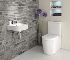 Space Saving Toilet Design for Small Bathroom - Home to Z Space Saving Toilet, Small Toilet Room, Guest Toilet, Downstairs Cloakroom, Downstairs Toilet, Bathroom Design Small, Bathroom Layout, Bathroom Wall, Bathroom Feature Wall