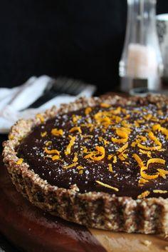 // vegan chocolate caramel tart with orange peel and salt